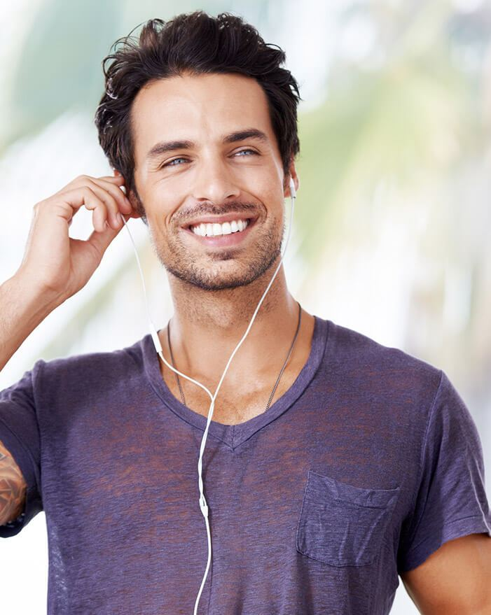 man smiling listening to music